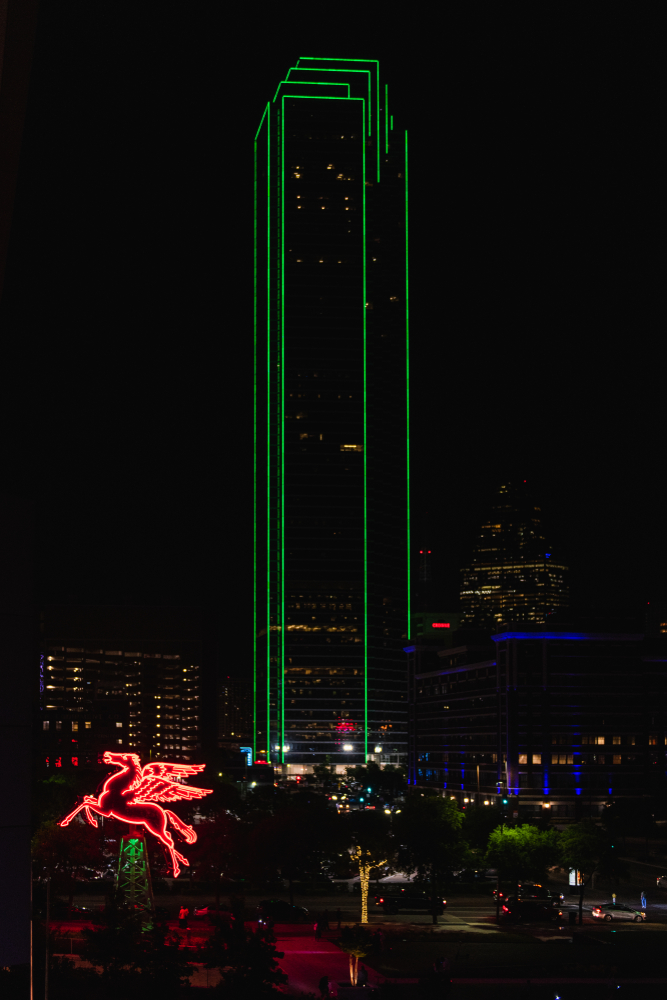 Night View of Bank of America Plaza Building and Omni Hotel Neon Mobil Pegasus Flying Horse in Downtown Dallas Texas